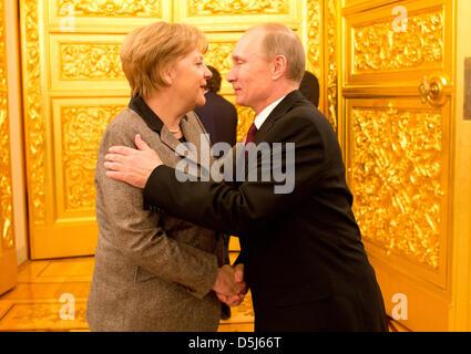 German Chancellor Angela Merkel greets the President of Russia Vladimir Putin during the 14th German-Russian intergovernmental - Stock Photo
