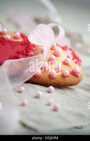 Pink heart shape cookies for Valentine´s Day celebration - Stock Photo