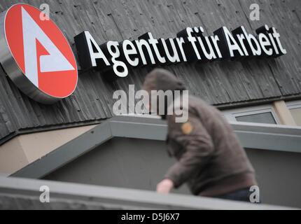 A man walks towards the Agentur fuer Arbeit (German employment agency) in Wiesbaden,Germany, 15 November 2012. - Stock Photo