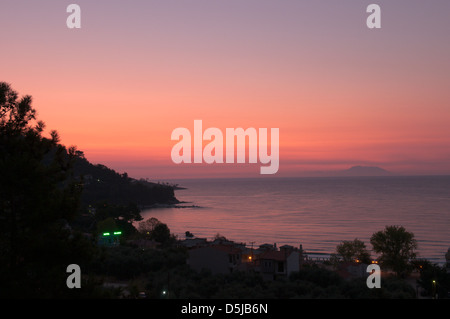 View from Golden beach Chrisi Ammoudia Skala Panagias eastward to Island of Samothrace Dawn sunrise - Stock Photo