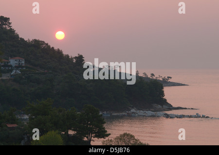 View from Golden beach Chrisi Ammoudia or Skala Panagias eastward to dawn sunrise - Stock Photo
