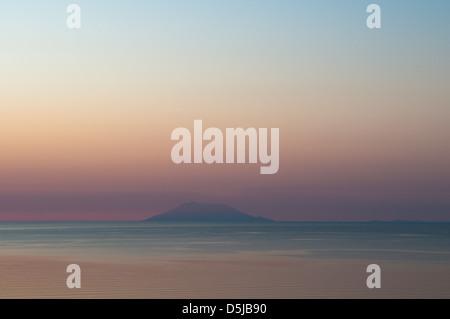 View from Golden Beach eastward towards the island of Samothrace Dawn sunrise - Stock Photo