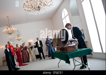 London, UK. 3rd April 2013. Guests  costumed in full period evening dress listen to a gramophone DJ set. The Salon - Stock Photo