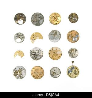 Pocket watch clockwork mechanisms on a white background - Stock Photo