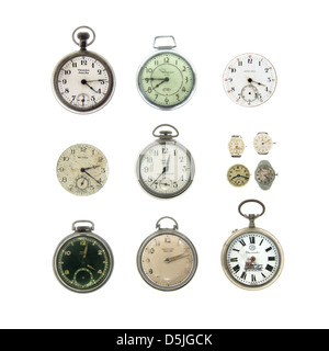A collection of antique and vintage pocket watches and wristwatches on a white background. - Stock Photo