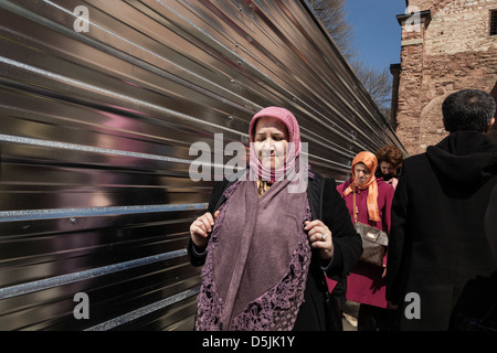 Women with Muslim veil outside the Hagia Sophia, Istanbul, Turkey. - Stock Photo