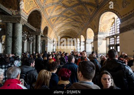Tourists crowded in Istanbul landmark Hagia Sophia, Turkey. - Stock Photo