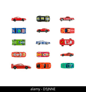 Toy racecars arranged in a grid on a white background. - Stock Photo
