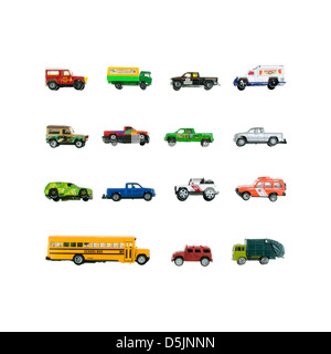 Toy trucks arranged in a grid on a white background. - Stock Photo