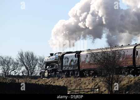 Preserved steam locomotive 48151 near Settle Junction with the Yorkshire Coast Express from Carnforth to Scarborough. - Stock Photo