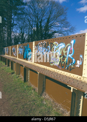 Graffiti On a Metal Bridge Along the South Staffordshire Railway Walk, Himley, Staffordshire, England, UK - Stock Photo