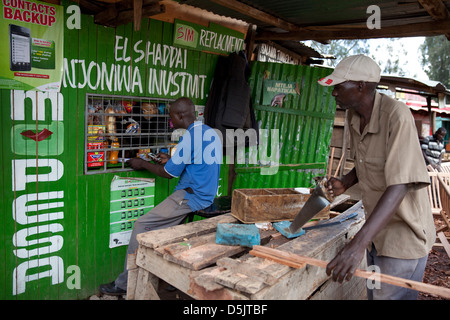 A Kenyan customer at an M-Pesa service outlet in Nairobi, Kenya on April 3, 2013. - Stock Photo