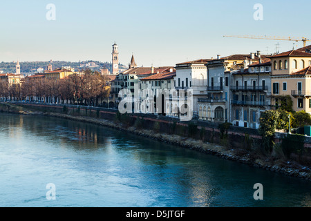 Adige River and buildings viewed from Castelvecchio Bridge (Ponte di Castelvecchio). - Stock Photo