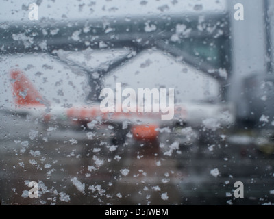 An easyJet aircraft is grounded due to poor weather conditions at London Gatwick airport. - Stock Photo