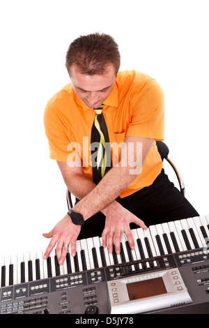 Man with crossed hands on the keys of synthesizer making instrumental music - Stock Photo