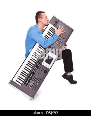 Enthusiastic musician kissing his favorite synthesizer - isolated - Stock Photo