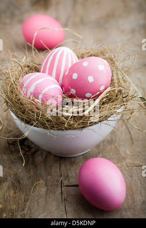 Painted easter egg in little bird nest - Stock Photo