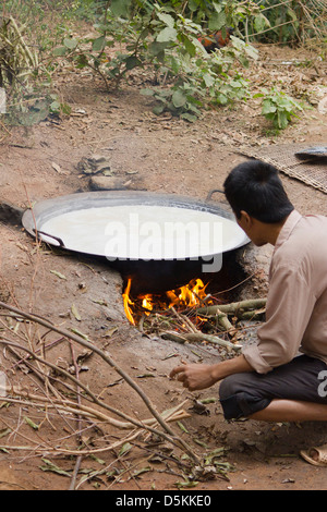 Cooking Rice In A Large Pot On An Open Fire In The Indian