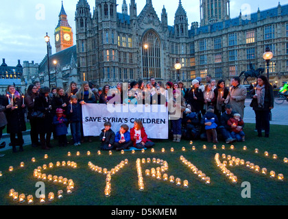 Candlelit Vigil outside Parliament to mark the 2nd anniversary of the war in Syria 14th March 2013 - Stock Photo