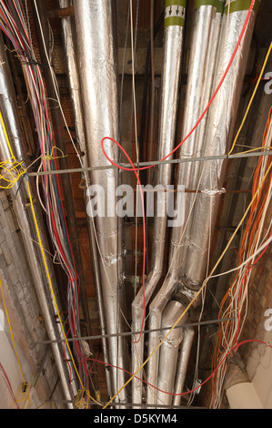 Exposed water heating mains central heating pipework lagged in Stock ...