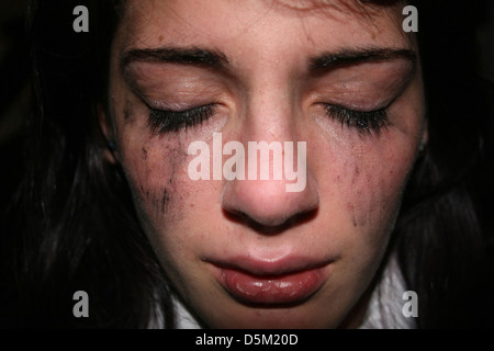 Young girl showing distress - Stock Photo