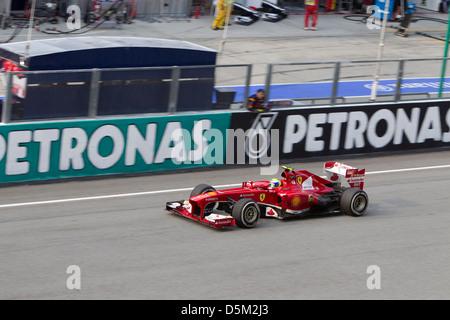 Brazilian Felipe Massa of Ferrari Racing team down the main straight at the Petronas Malaysian Formula 1 GP - Stock Photo