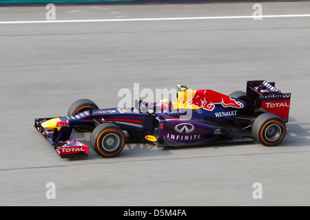 Mark Webber of team Red Bull down the main straight at the Malaysian F1 GP - Stock Photo