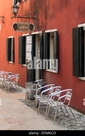 empty colorful chairs in front of grey wall stock photo