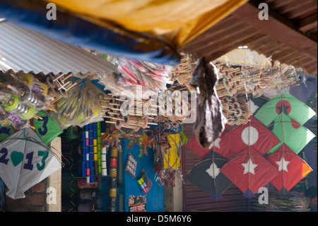An Indian kite shop selling brightly coloured kites and accessories.  Varanasi, India. - Stock Photo