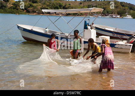 Madagascar, Nosy Be, Marodokana, women fishing in shallows at high tide - Stock Photo