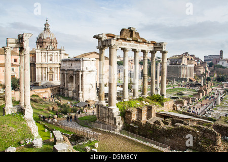 View of the Roman Forum with the Temple of Saturn and Arch of Septimius Severus in the background. - Stock Photo