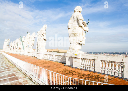 Apostle statues on the roof of Basilica of Saint Peter. - Stock Photo
