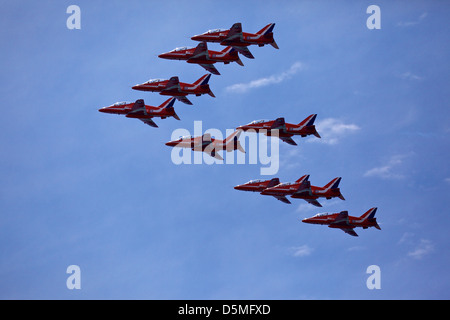 Red Arrows RAF aerobatics display team in formation over Lyme Regis, Dorset, UK - Stock Photo