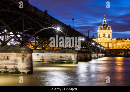 Pont des Arts and Institut de France (French Institute) at evening. - Stock Photo