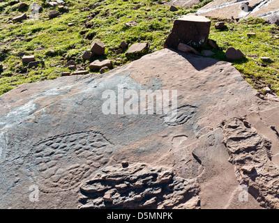 Prehistoric rock carvings at Oukaimeden Ski Resort in the High Atlas Mountains Morocco - Stock Photo