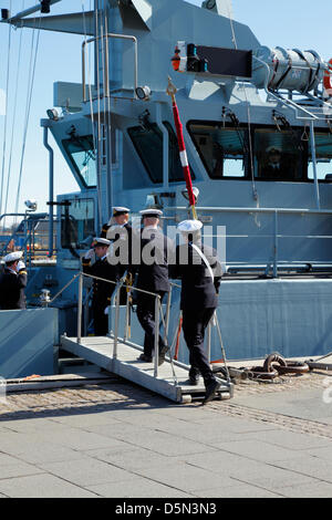Copenhagen, Denmark. April 4th 2013. Cadets from the Royal Danish Naval Academy parade the flag on board the naval - Stock Photo