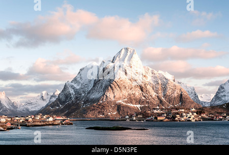 A view looking north up Reine harbour towards Olstind on the Lofoten islands - Stock Photo
