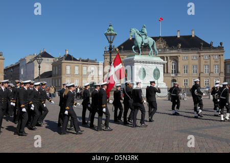 Copenhagen, Denmark. April 4th 2013. Cadets from the Royal Danish Naval Academy accompanied by the playing and singing - Stock Photo
