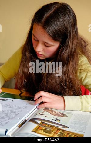 A young Girl doing Homework, Ireland - Stock Photo