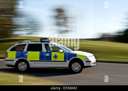 Panning with rear sync flash of a police car while speeding around a roundabout in urban Dundee, UK - Stock Photo