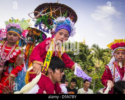 Chiang Mai, Thailand. 5th April 2013. Boys are carried through the grounds of Wat Pa Pao during the Poi Sang Long - Stock Photo