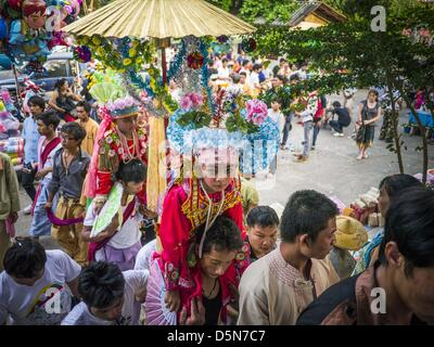 Chiang Mai, Thailand. 5th April 2013. Boys are carried prayer hall of Wat Pa Pao during the Poi Sang Long festival. - Stock Photo