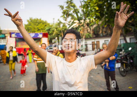 Chiang Mai, Thailand. 5th April 2013. A man dances of the grounds of Wat Pa Pao during the Poi Sang Long Festival - Stock Photo