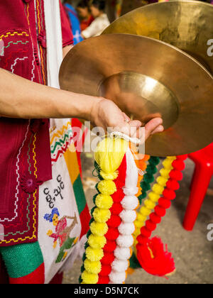 Chiang Mai, Thailand. 5th April 2013. A cymbals player at the Poi Sang Long Festival in Wat Pa Pao. The Poi Sang - Stock Photo
