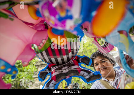 Chiang Mai, Thailand. 5th April 2013. A toy vendor sells inflatible toys at the Wat Pa Pao Poi Sang Long Festival - Stock Photo