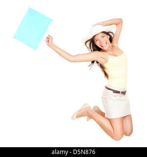 Portrait of cheerful excited mixed race young woman with shopping bag jumping isolated on white background - Stock Photo