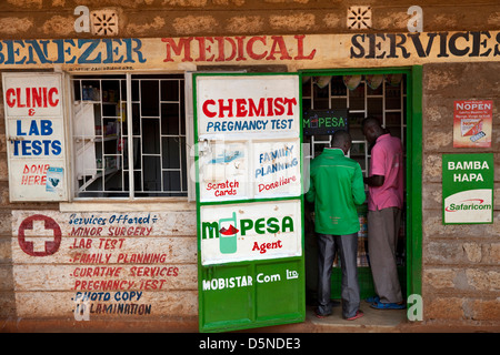 Kenyan customers at an M-Pesa service outlet in Nairobi, Kenya . - Stock Photo