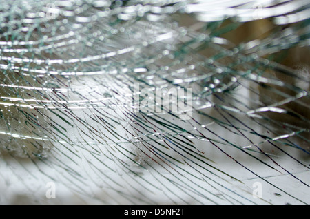 Cracked glass in a smashed windshield - Stock Photo