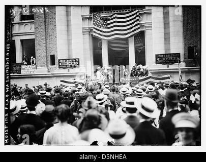 Hoisting flag - Wash. High School (LOC) - Stock Photo