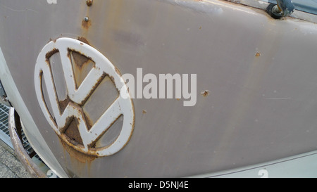 A VW badge on an old Volkswagen van. - Stock Photo